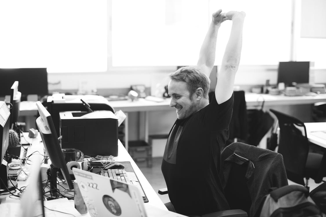 stretching at office desk