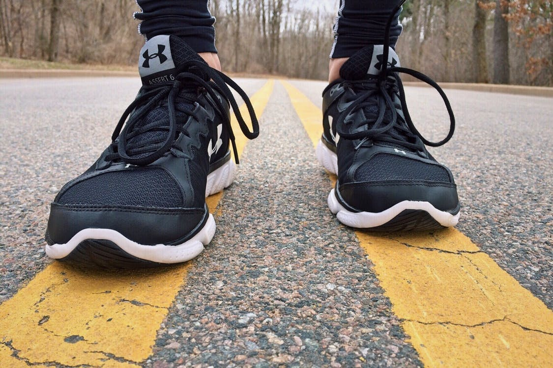 womens sneakers on the roadway fitness