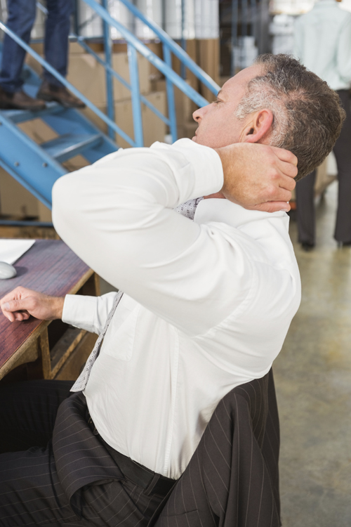 Worker Holdeing Their Neck in Pain on the Job