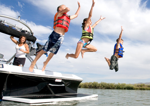 Kids Jumping Off Boat Into the Water