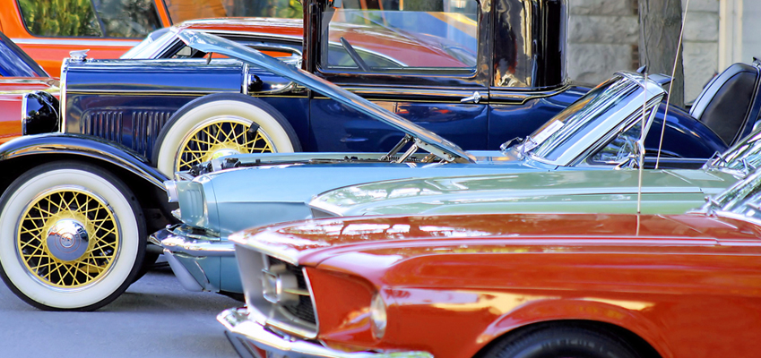 Photo of Classic Cars Lined up at a Car Show