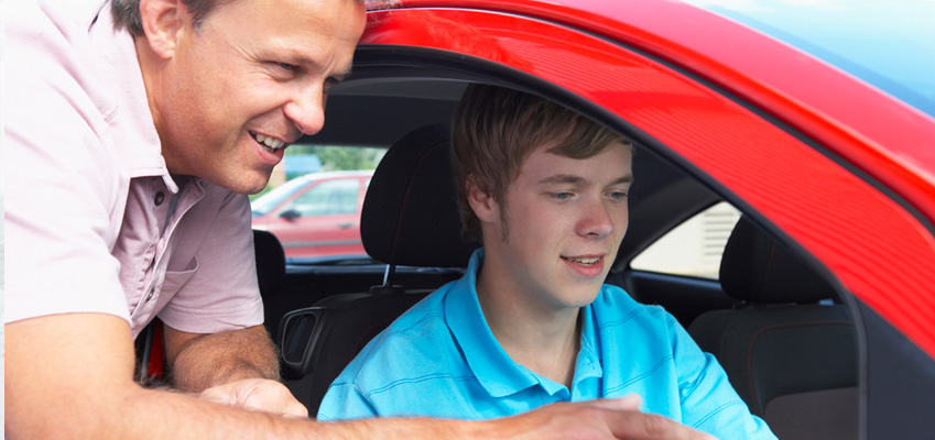 Father with Son Giving Driving Tips